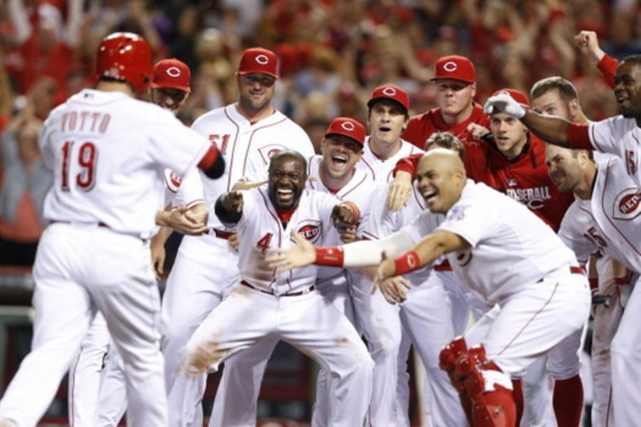 The Reds celebrate after a rare bright spot in their 2015 season, a Joey Votto walk-off home run.