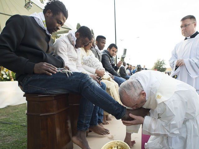 Pope Washes the Feet of Twelve Migrants